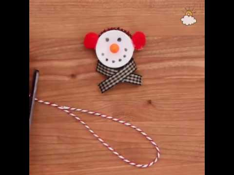 Transform tea lights into adorable light-up snowmen ornaments. What a creative holiday project!