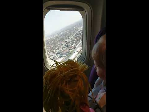 3 Year old taking off in a plane for the first time