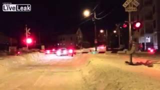 train plows through snow