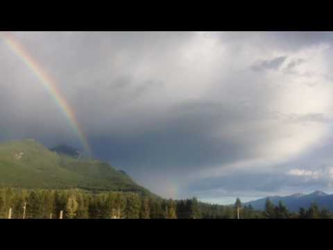 Rainbow in golden bc canada double a mother and a baby rainbows