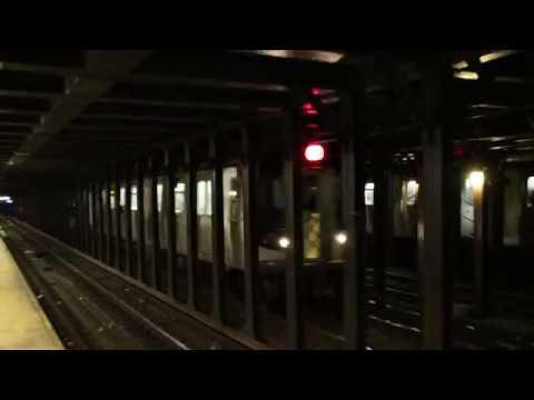 MTA NYC Subway N & W trains at 8th St/NYU