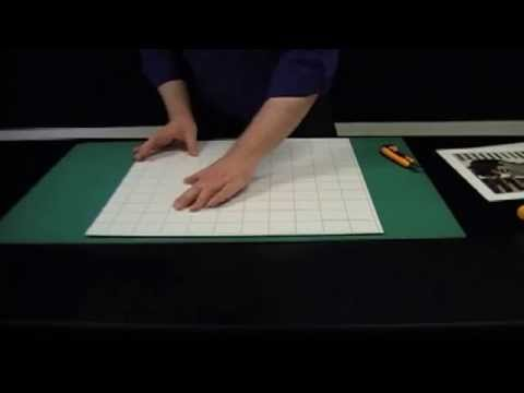 Mounting a photo or print by hand onto self adhesive board