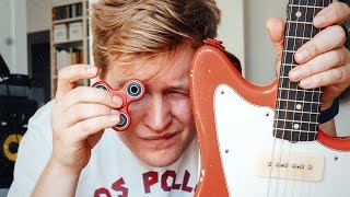 Playing guitar with a FIDGET SPINNER?!