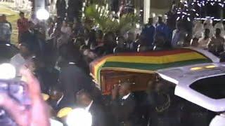 Coffin of ex-president Mugabe arrives at his former residence