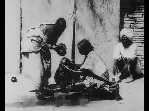 Old Indian Style of bathing babies