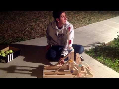 How to build a very cheap yet very powerful catapult (powered by rubber bands)