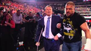 Triple H assists Mr. McMahon backstage after their fight with Brock Lesnar & Paul Heyman