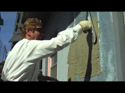 Skim coat over stucco cinder block brick or plaster