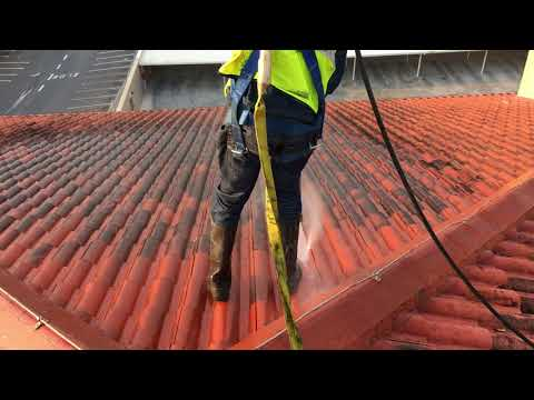 High pressure washing of tile roof