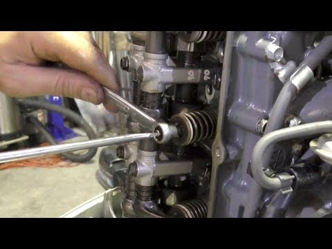 Outboard valve clearance adjustment