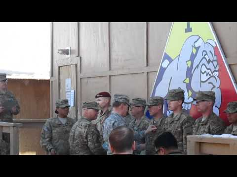 Chairman of the Joint Chiefs of Staff Gen. Dempsey awards the Army Commendation Medal with Valor