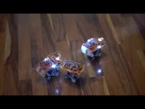 Logic gate based robots that flock together using light