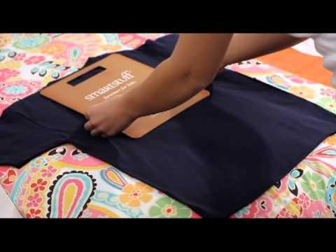 How to fold a shirt using a folding board