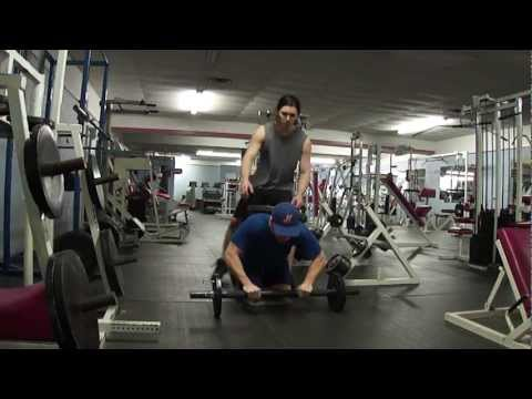 Matt - ab rolls with ''homemade'' ab wheel ,bodyweight + 100lb. plate on back for 10 reps