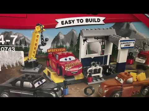 Young boy builds LEGO junior - Lightning McQueen Smokey's Garage