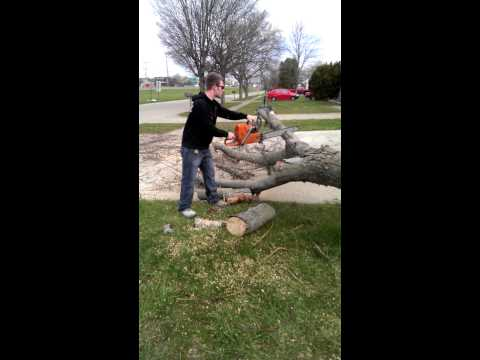 Little bro learning to cut trees