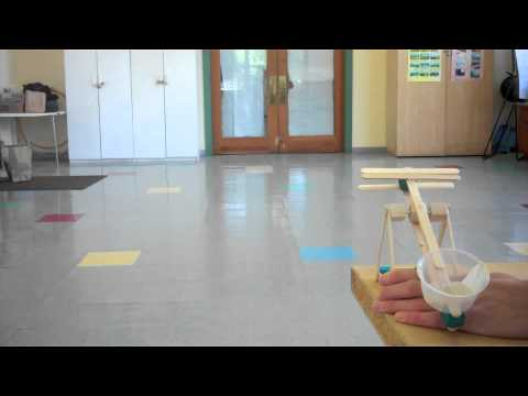 Mini desktop catapults, powered by rubber bands and built for kids