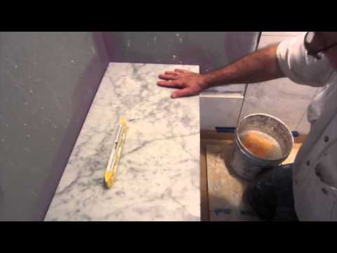 How to install marble on  bench seat and shower curb