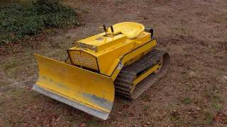Mini Bull Dozer Magna Trac Junior moving 700lbs of sod with