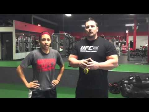 Coach Gary Miller at UFC GYM with client Felicia relative body strength
