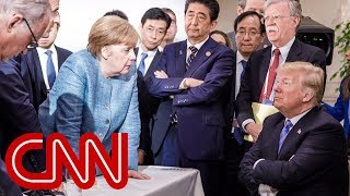 G7 photos of Trump with Merkel tell different stories