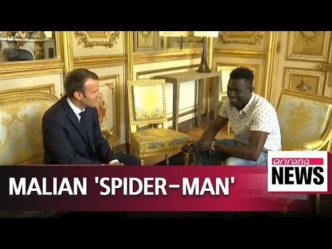 Malian migrant who scaled building to rescue child to get French citizenship, job as fireman