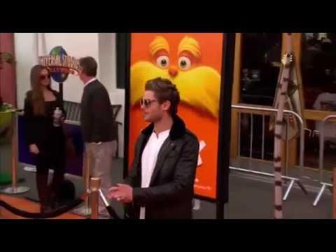 Zac Efron Drops A CONDOM On The Lorax Premiere Orange Carpet