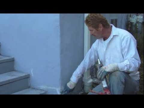 Repair stucco or plaster cracks with caulking