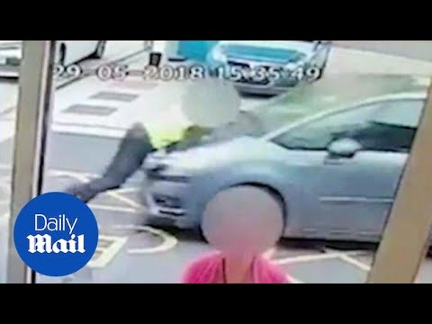 Shocking moment driver ploughs into BP garage employee - Daily Mail