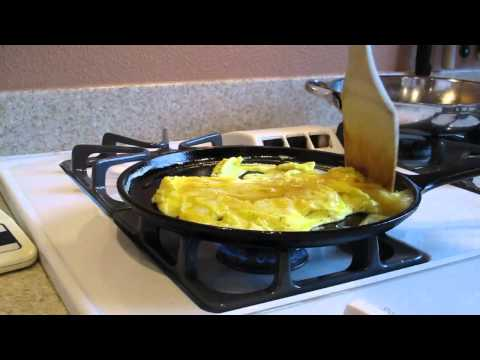 Scrambling eggs on a cast iron griddle