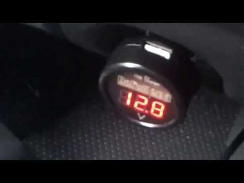 Using a cigarette lighter Voltmeter to check alternator charge.