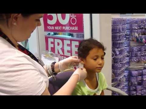 Julia getting her ears pierced at Claire's in the mall 05/26/2013