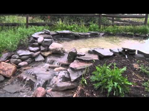 Swales, Ponds, and Spillways in the Rain 2