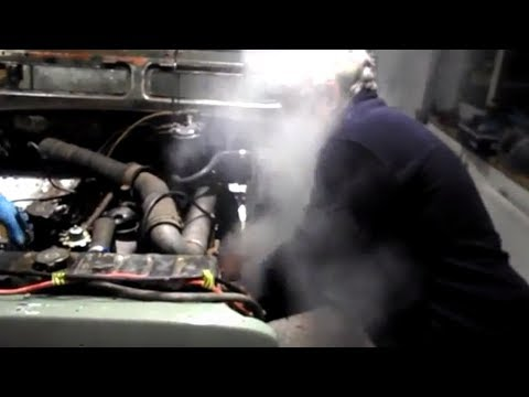 Mechanic gets a face full of exhaust!