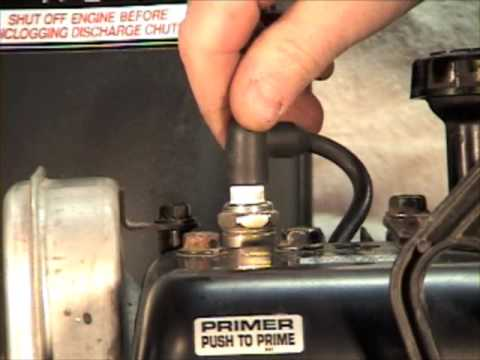 Spark plug replacement in 2 stage snow thrower.