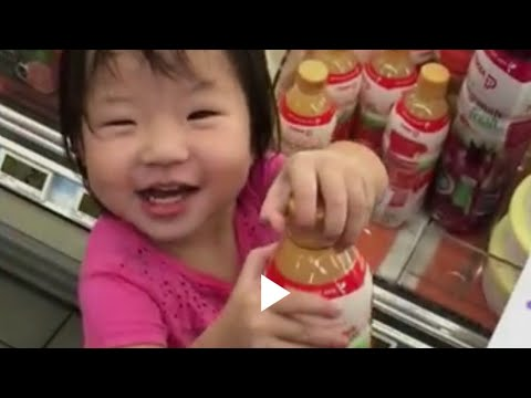 Baby and brother help mummy buy stuffs in supermarket