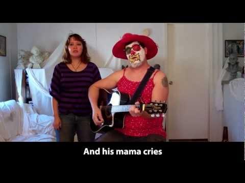 In Stilettos.  Clown Parodies Elvis Presley's