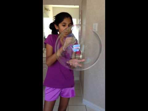 Kirti making a giant bubble with soap water