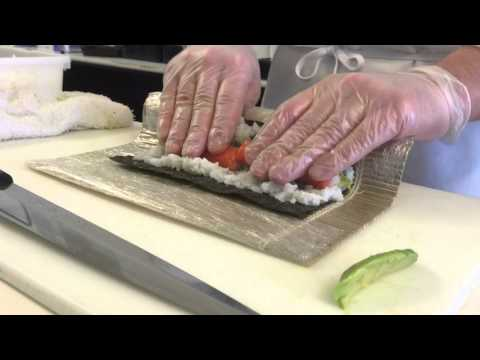 A sushi chef's demonstration of the technique for making a California roll