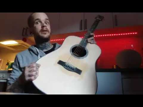 How do you make your acoustic guitar sound better?