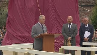 Prince Charles unveils a statue of his grandmother, the Queen Mother