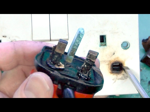 Overheated Plug and Damaged Socket Outlet