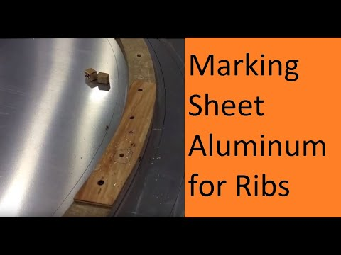 Marking and cutting sheet aluminum to make a rib for the B-17 Flying Fortress.