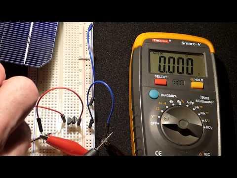 Breadboard multimeter testing N channel JFET J310 transistors with broken solar cell