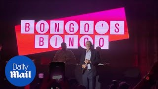 Jeremy Corbyn calls out bingo numbers onstage in Liverpool