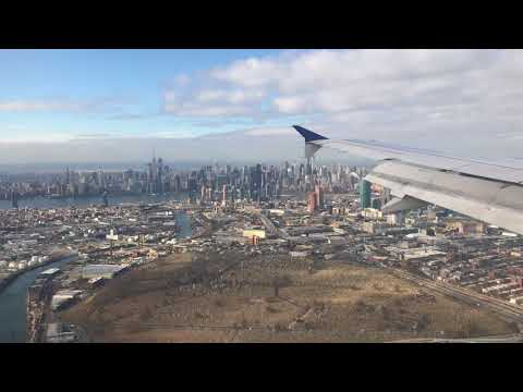 Airplane Landing in New York City Laguardia Airport