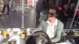 Finn Wittrock signing autographs in Hollywood at Ryan Murphy Walk of Fame ceremony