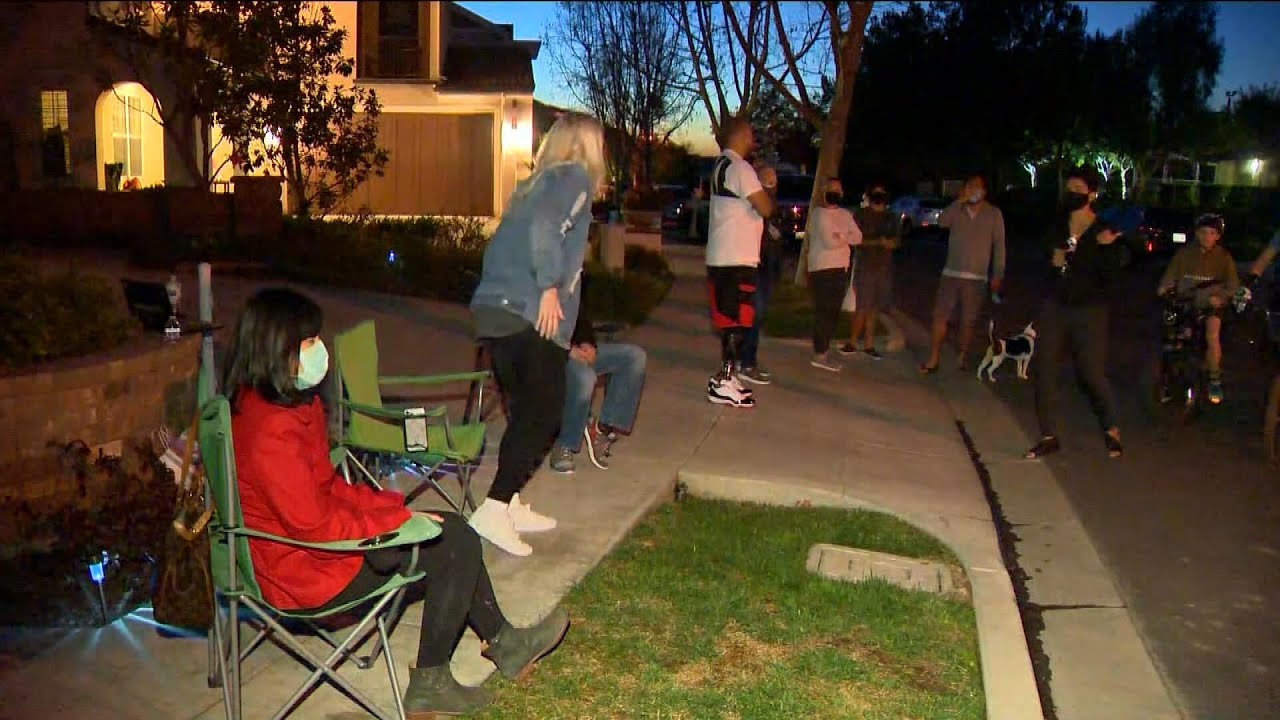 Neighbors of Harassed Asian Family Take Turns Standing Guard