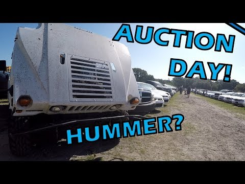 Auction Day: Hummer, Buses, Limo, Police Car Parts