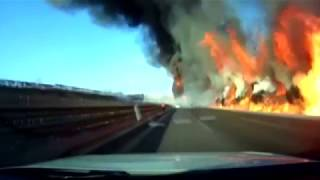 Truck bursts into fire after turning over in north China